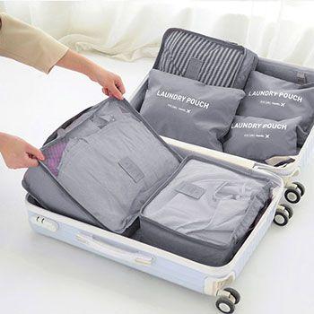 6 versch. Reisetaschen in versch. Farben für den Koffer für je 4,80€