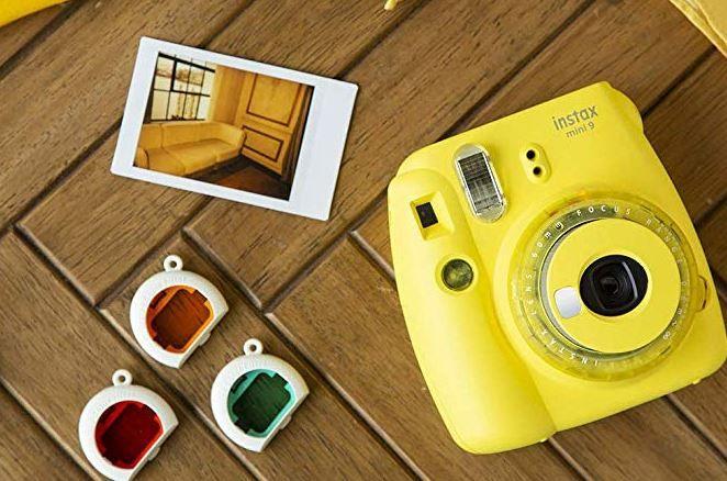 Fujifilm Instax Mini 9 Sofortbildkamera in Gelb oder Lila für  je 49€ (statt 60€)