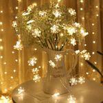 Schneeflocken LED-Lichterketten 10m mit 100 LEDs in Warmweiß mit 8 Modi für 8,49€ (statt 17€)