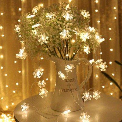 Schneeflocken LED Lichterketten 10m mit 100 LEDs in Warmweiß mit 8 Modi für 8,49€ (statt 17€)